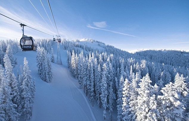 Aspen, Colorado, USA --- Aerial Tram Over Ski Slope --- Image by © Grafton Smith/Corbis
