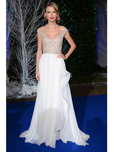 LONDON, ENGLAND - NOVEMBER 26: Taylor Swift attends the Winter Whites Gala in aid of Centrepoint at Kensington Palace on November 26, 2013 in London, England. (Photo by Karwai Tang/WireImage)