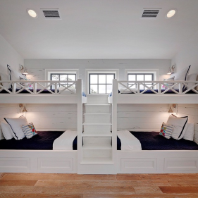 white-built-in-bunk-beds-staircase-navy-border-bedding